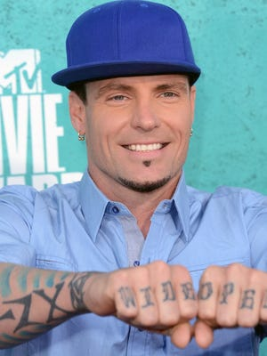 ORG XMIT: 145512154 UNIVERSAL CITY, CA - JUNE 03:  Recording artist Vanilla Ice arrives at the 2012 MTV Movie Awards held at Gibson Amphitheatre on June 3, 2012 in Universal City, California.  (Photo by Jason Merritt/Getty Images) ORIG FILE ID: 145697423