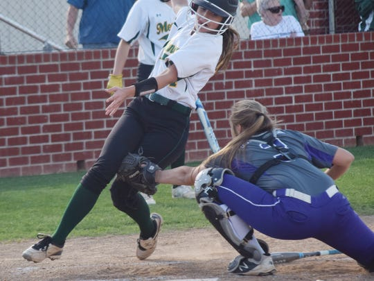 Rosepine's catcher Lauryn McMahon (3, right) tags Holy Savior Menard's Tara McVay (4, left) out before she can cross home plate.