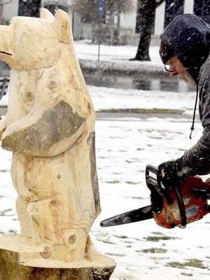 A chainsaw carving is the Take Out Tuesday/Winter Fest prize going to four winners of the Coldwater Area Chamber of Commerce drawing.
