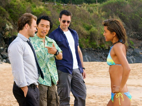 Scott Caan,  Daniel Dae Kim, Alex O'Loughlin and Grace Park in CBS drama 'Hawaii Five-0.' Park and Kim left the series after a pay dispute.