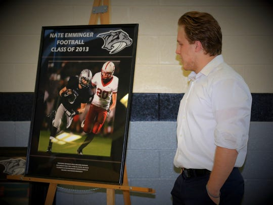 Admiring his Hall of Fame photo plaque Monday is Nate