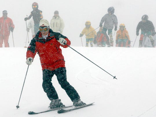 FILE - A Tuesday, Feb. 20, 2007 file photo of Russian President, Vladimir Putin, skiing  down a slope in the Krasnaya Polyana area outside the Black Sea resort of Sochi, southern Russia. The Russian president told Olympic historian David Miller in an exclusive interview made available on Friday May 5, 2017, that his country has plenty of candidates capable of hosting the Summer Games, not just Moscow. (AP Photo/ Mikhail Metzel, File)