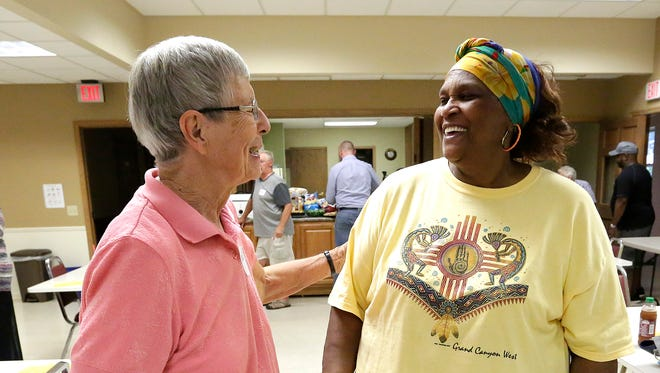 Janet Ahler and Rufus Frazier of Fond du Lac meet up Friday at a Humanity Project potluck held  at the Fond du Lac Senior Center. The gathering celebrated the year-long, diverse partnerships that  were created through the project.