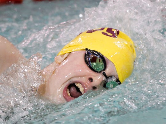 McCutcheon's Kate Gallagher on her way to winning the 200 freestyle with a time of 2:04.85 against Harrison Tuesday, December 15, 2015, at McCutcheon High School.
