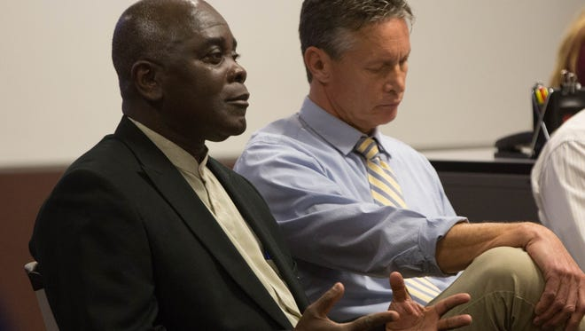 Festus Addo-Yobo, director of Black Programs at NMSU, discusses issues surrounding statues from the Civil War and other historical events during a SPACE NMSU Panel discussion at the NMSU Health College Auditorium Tuesday, November 14, 2017.