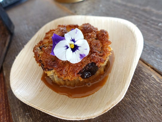Mini brioche bread pudding with almond, tart cherry, dried cranberries and dulce de leche from Quiessence at the 2017 azcentral.com Food & Wine Experience.