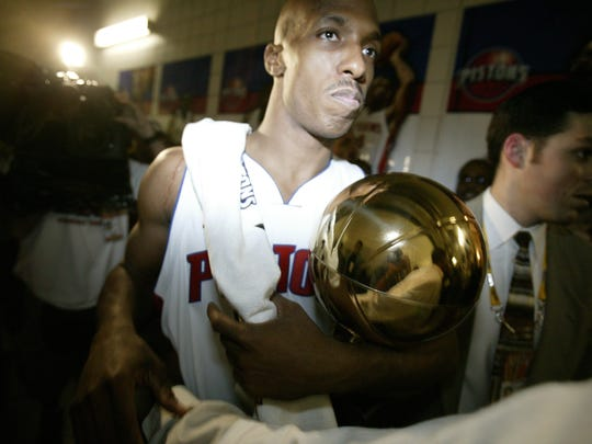 NBA Finals MVP Chauncey Billups carries his trophy June 15, 2004, at the Palace of Auburn Hills.