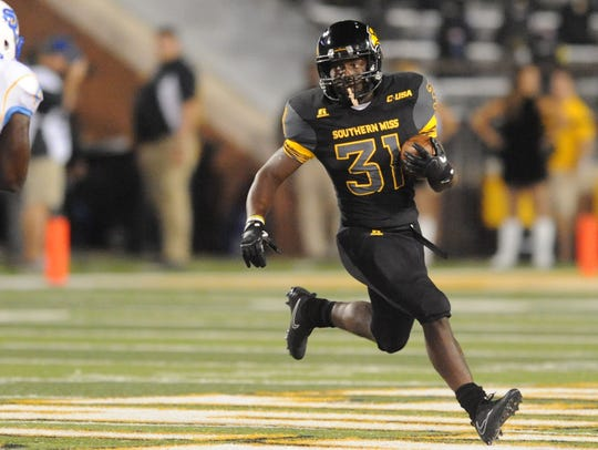 Southern Miss freshman running back Andre Hale II carries
