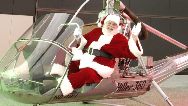 Since reindeer won't always do the trick, Santa uses a helicopter to land at the Hiller Aviation Museum in San Carlos, Calif.