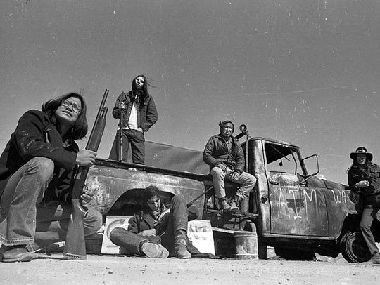 American Indian Movement militants man a checkpoint on the road leading into Wounded Knee, South Dakota, in 1973.