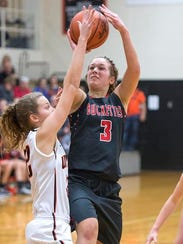 Buckeye Central's Jenna Karl attempts a shot over the