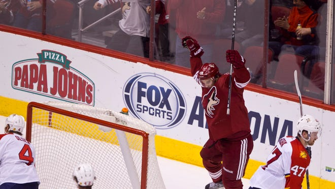 The Coyotes' Antoine Vermette celebrates a goal in the first period against the Panthers at Jobing.com Arena on Thursday, March 20, 2014 in Glendale.