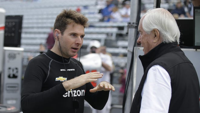 Will Power, left, talks with Roger Penske during a practice session for the Indy 500. Power finished second last year.