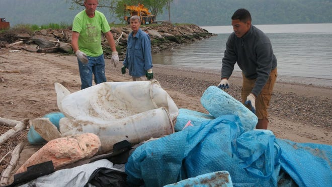 Volunteers clean up the Hudson River shore in Hastings-on-Hudson as part of the 2013 Riverkeeper Sweep. The 2014 Sweep took place May 10.