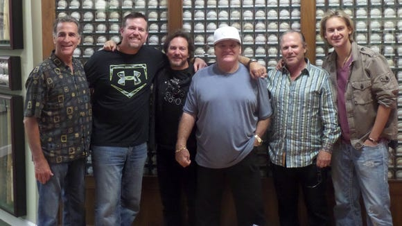 Chris Welsh, Sean Casey, Eddie Vedder, Pete Rose, Bob Crotty and Bronson Arroyo at the Green Diamond Gallery in Montgomery on Monday.