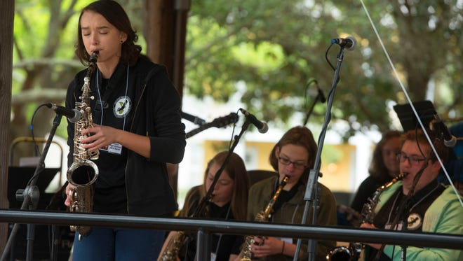 Adeline Belova of the Milton High School Blackwater Beach Jazz Band performs Sunday, April 8, 2018 during the final day of the Pensacola JazzFest in Seville Square.
