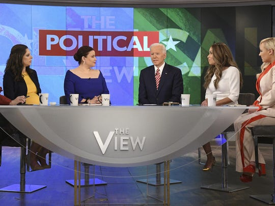 "This image released by ABC shows Democratic presidential candidate Joe Biden, third from right, with co-hosts, from left, Joy Behar, Abby Huntsman, Ana Navarro, Sunny Hostin and Meghan McCain during an appearance on ""The View,"" Friday, April 26, 2019."