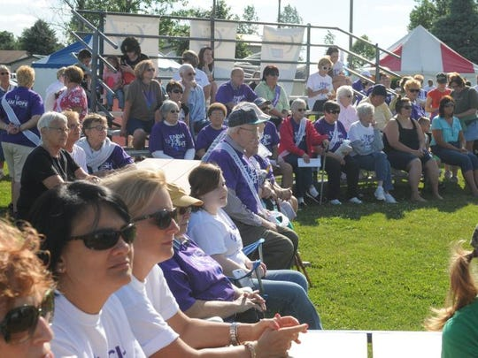 Spectators gather for a past Relay For Life's opening ceremony, which will take place at 12 p.m. on Saturday in Conner Park.