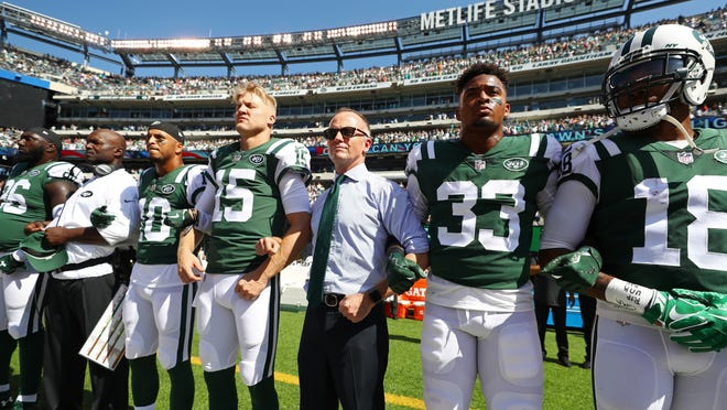 EAST RUTHERFORD, NJ - SEPTEMBER 24:  Jermaine Kearse #10 and Josh McCown #15, Jamal Adams #33 and Christopher Johnson CEO of the New York Jets stand in unison with their team during the National Anthem prior to an NFL game against the Miami Dolphins at MetLife Stadium on September 24, 2017 in East Rutherford, New Jersey.  (Photo by Al Bello/Getty Images) ORG XMIT: 700070634 ORIG FILE ID: 853052070