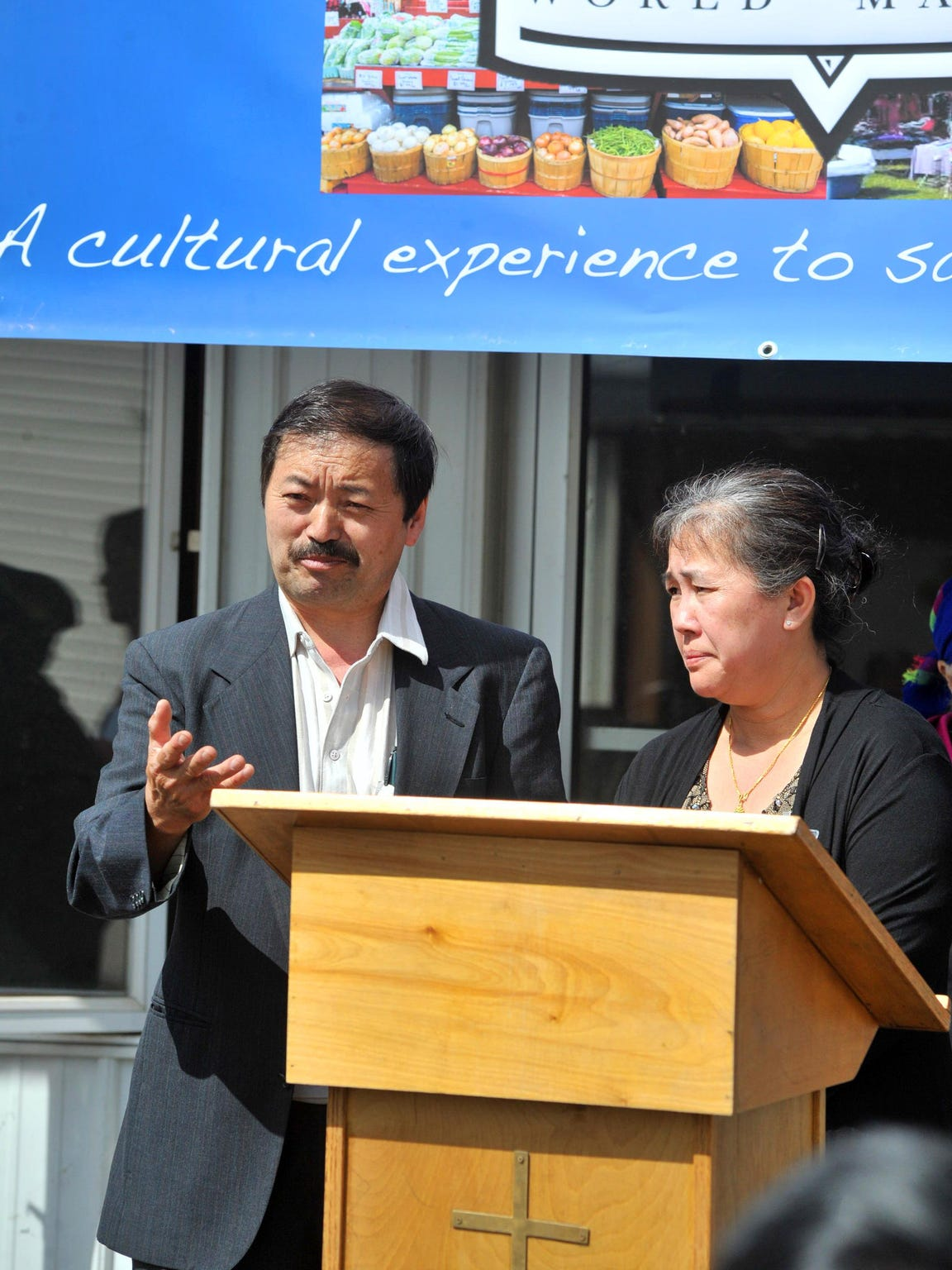 Owners Chungsou Her, left, and his wife Mai, both of Wausau, make a speech during the August groundbreaking ceremony at the future location for Wausau World Market on Third Avenue in Wausau.