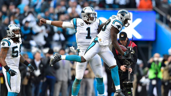 Jan 17, 2016: Carolina Panthers outside linebacker Thomas Davis (58) and Cam Newton (1) celebrate Davis's onside kick recovery in the fourth quarter during the NFC Divisional round playoff game at Bank of America Stadium. The Panthers defeated the Seahawks 31-24.