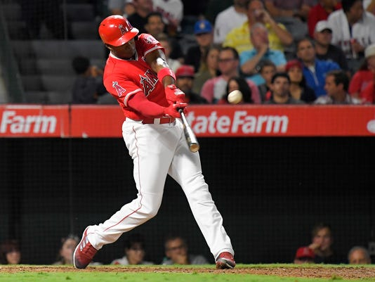 Los Angeles Angels' Justin Upton hits a solo home run during the sixth inning of a baseball game against the Houston Astros, Wednesday, Sept. 13, 2017, in Anaheim, Calif. (AP Photo/Mark J. Terrill)