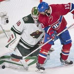 The Minnesota Wild's goalie Devan Dubnyk stops the Montreal Canadiens' Mike Brown (13) during the third period Saturday in Montreal.