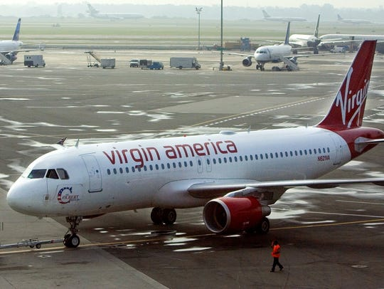 An Airbus jet carrying Richard Branson is pushed back