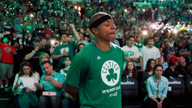 Boston Celtics' Isaiah Thomas stands by himself during team introductions before a first-round NBA playoff basketball game against the Chicago Bulls on April 16, 2017 in Boston.