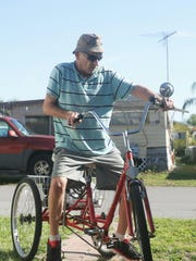 Sam Powers uses his trike daily for exercise, taking