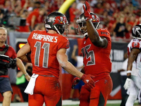 Tampa Bay Buccaneers wide receiver Adam Humphries (11) is congratulated by running back Mike James (25) after he scored a touchdown against the Atlanta Falconsduring the second half at Raymond James Stadium. Atlanta Falcons defeated the Tampa Bay Buccaneers 43-28.