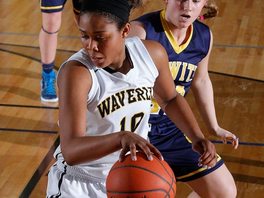 Waverly's Breanna Mobley, left, maneuvers against DeWitt's