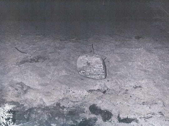 A blood-stained rock is photographed at the scene of a murdered woman found north of Palm Springs in March 1972.