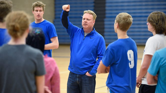 Sartell track coach Ross Anderson works with team members Friday in the school gymnasium in Sartell.