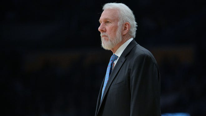 San Antonio Spurs head coach Gregg Popovich watches game action against the Los Angeles Lakers during the first half at Staples Center.
