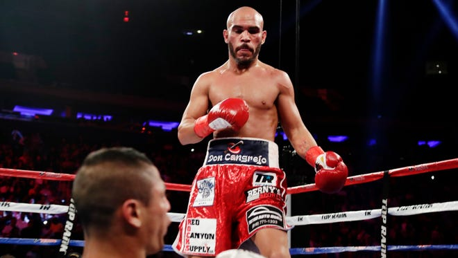 Ray Beltran stares down Jonathan Maicelo after knocking him out in the second round in his last fight.