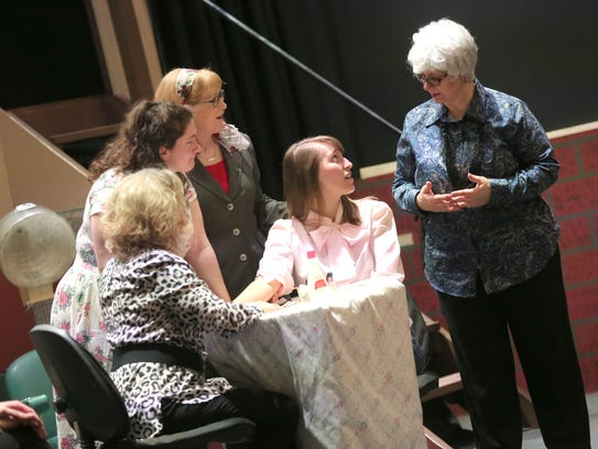 Bethany Herman (seated) and Hannah Cooper, along with