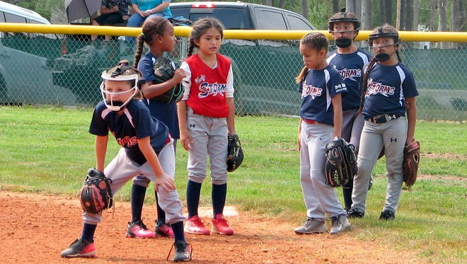 Girls wait their turn at the USSSA Youth Fast Pitch competition.