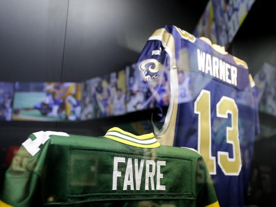 "Game-worn Brett Favre and Kurt Warner jerseys are among the 200-plus artifacts in ""Gridiron Glory: The Best of the Pro Football Hall of Fame."""