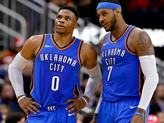 FILE - In this Saturday, April 7, 2018 file photo, Oklahoma City Thunder guard Russell Westbrook (0) and forward Carmelo Anthony (7) talk during the second half of the team's NBA basketball game against the Houston Rockets in Houston. Anthony has been the No. 1 option for whatever team he has played on during most of his basketball career. He knew that wasn't going to be the case when he arrived in Oklahoma City, though it's safe to say things haven't gone as he expected when he signed up to be part the league's next Big Three. (AP Photo/Michael Wyke, File)