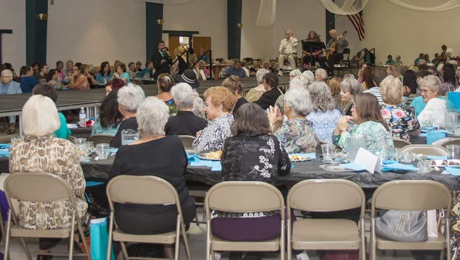 Turquoise and Silver Tea guest listen to music during last year's event.