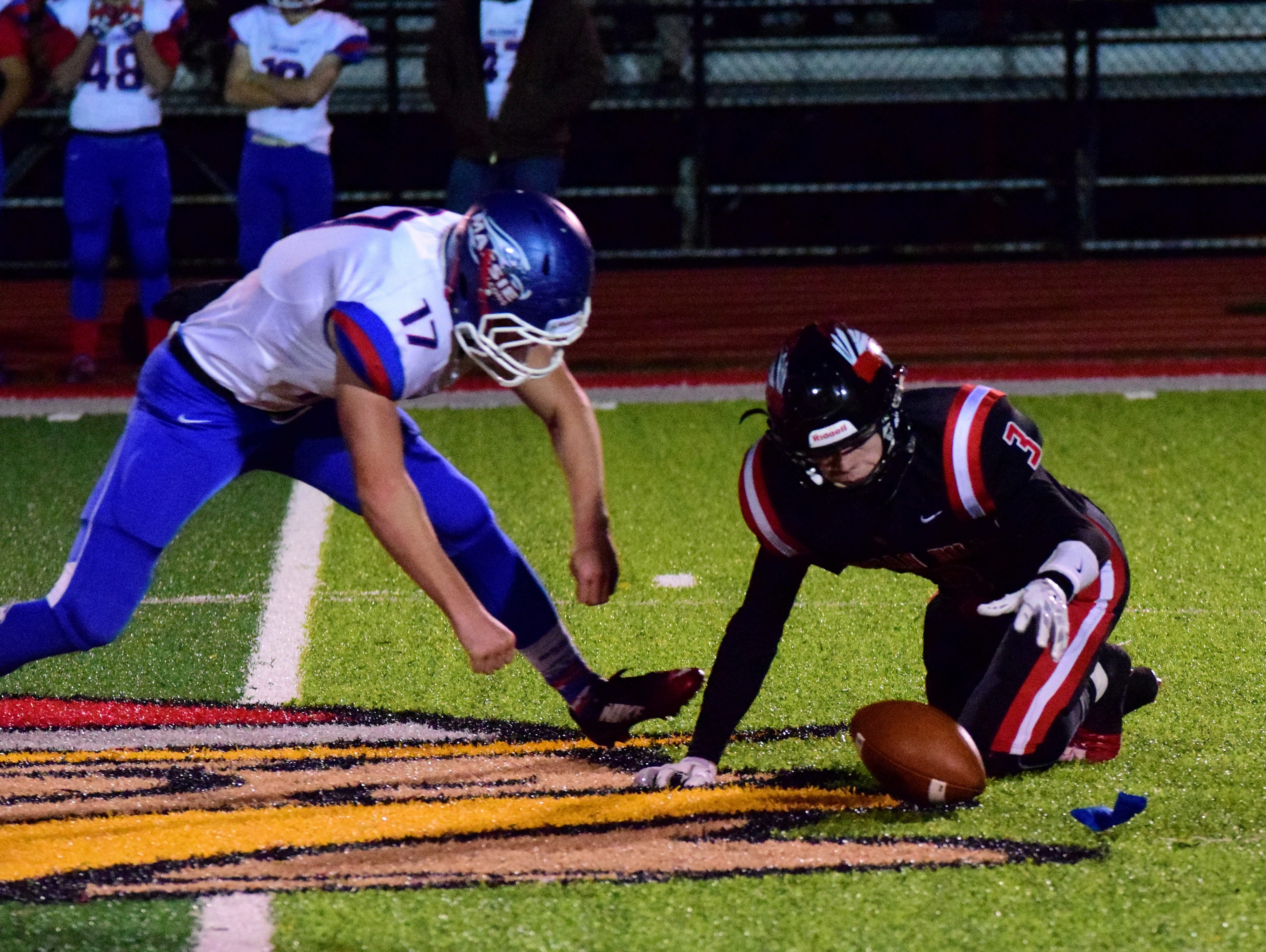 Clinton-Massie's Anthoney Tissandler (17) moves in to scoop up the fumbled punt return of Indian Hill's Nick Heidel (3). November 14, 2015