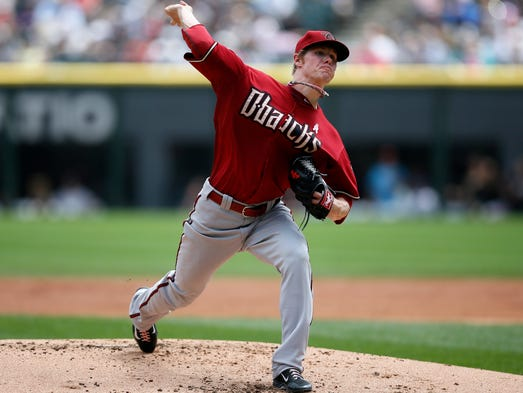 Arizona Diamondbacks starting pitcher Chase Anderson delivers against the Chicago White Sox during the first inning of a baseball game on Sunday, May 11, 2014, in Chicago.