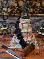 The wedding cake dripped fake blood and was crowned with the same gory cake topper that was used on Lowell and Diane Krumnow's wedding cake.
