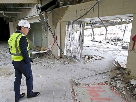 Developer Don Sinex gives a tour of the demolition