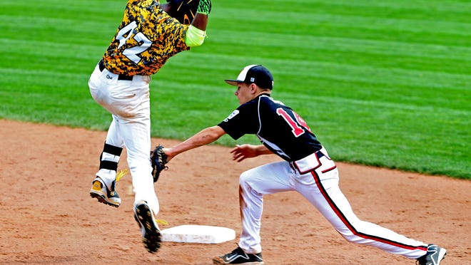 Jackie Robinson West Little Leaguer Pierce Jones tries to avoid being tagged out by New Albany's Cooper Biven during the Little League Baseball Central Regional Championship in Lawrence, Ind. on Aug. 9.