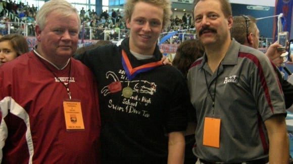 Rex Wells, left, with former state-championship swimmer Austin Lechner and ex-swimming coach Keith Corbeil.