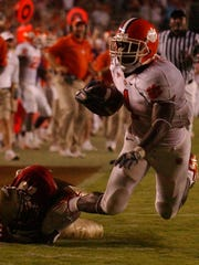 Clemson's James Davis is tackled by Florida State's Michael Ray Garvin inside the 5-yard line on Sept. 16, 2006 in Tallahassee. Davis' 47-yard run set up a first-and-goal and Davis scored the game-winning touchdown three plays later.