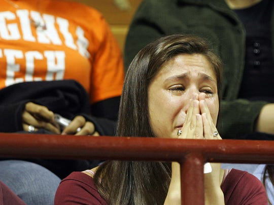 Virginia Tech student Angella De Soto, of Richmond, Va., cries prior to the start of a ceremony honoring the victims of the Virginia Tech shooting in Blacksburg, Va., Tuesday, April 17, 2007.
