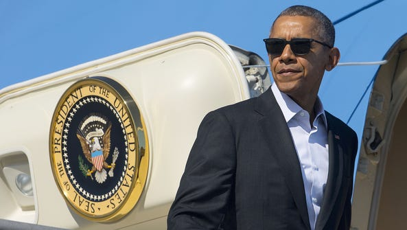 President Obama boards Air Force One at Los Angeles